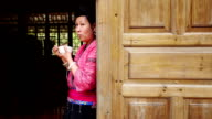 Chinese woman eating rice in traditional clothes video