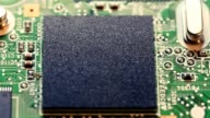 Chips on a electronics  printed circuit board video