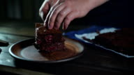 Chocolate brownie on plate. Chef serve chocolate dessert on plate video