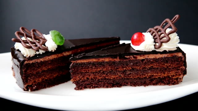 Chocolate cake on the white plate video