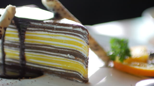 Chocolate cake with chocolate cream at coffee cafe video