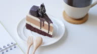 Chocolate cake with chocolate cream , dolly shot moving video