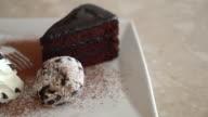chocolate cake with ice-cream and whip cream video