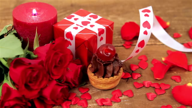 Chocolate cupcake with roses and gift on wood video