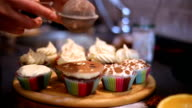 Chocolate cupcakes on a brown table video