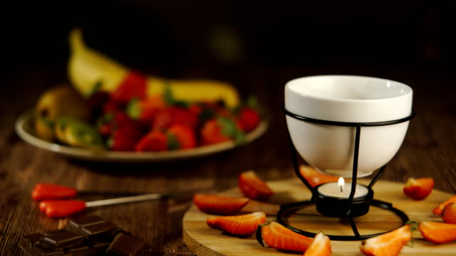 Chocolate fondue with fruits served in a restaurant video