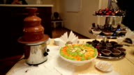chocolate fountain and fruit on the table video
