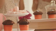 Chocolate muffins and candies on party table video