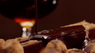 Chocolate pouring, dripping Into cacao slow motion video