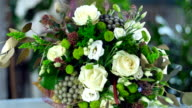 Choose bouquets in the showcase of a flower shop and send them to your loved ones video