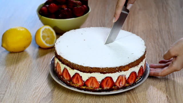 Chop a slice of strawberry cake with a knife video