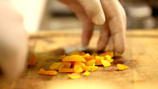 chopping dried apricots video