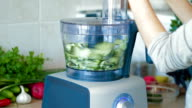 Chopping fresh cucumbers in blender for hash video
