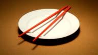 Chopsticks on a plate video