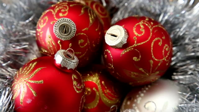 Christass decorations white and red balls on rotating table close-up. video