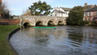 Christchurch Dorset England UK River Avon with bridge and green boat video