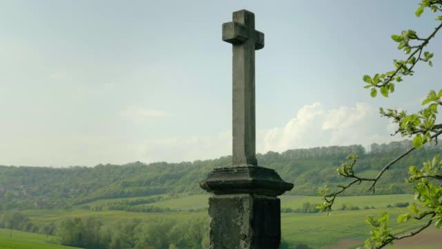 Christian cross on background is beautiful European landscape. Village Baroque style. video