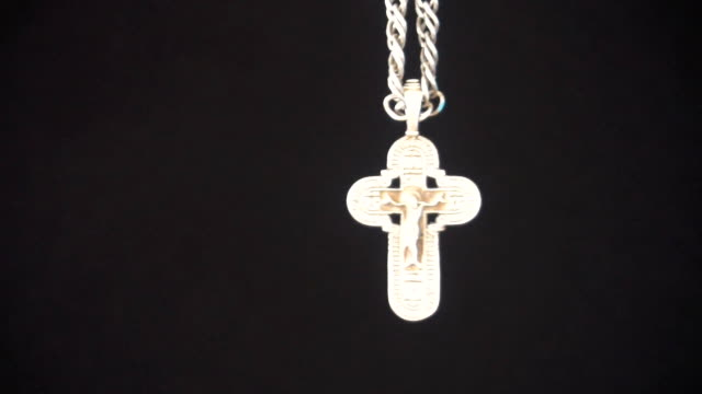Christian cross on black background,slow motion video