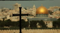 Christian Cross with Muslim Dome of the Rock in background video