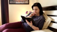 Christian woman reading the Holy Bible video