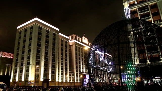 Christmas and New Year holidays illumination and Building of The State Duma of the Federal Assembly of Russian Federation at night, Moscow, Russia video