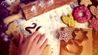 Christmas baking background. The girl writes on a table 2017 video