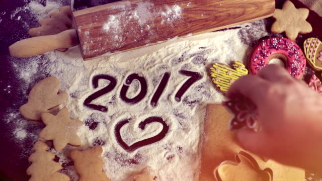 Christmas baking background. The inscription on the table in 2017 video