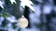 Christmas Ball Hanging on Winter Tree PAN video