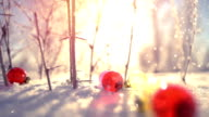 Christmas balls and snowfall close-up slowmotion video