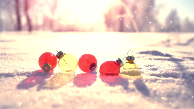 Christmas balls on snow in winter park slowmotion video