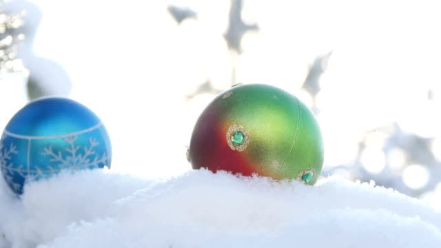 Christmas balls on snow-covered fir branch video