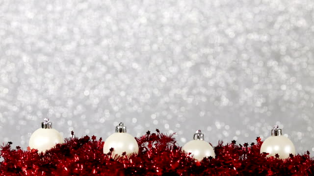 christmas baubles on shiny defocused background video