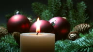christmas candle and red baubles video