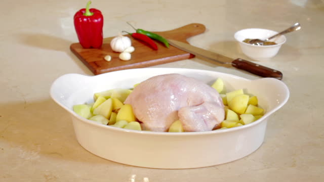 Christmas chicken for roasting on table video