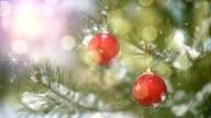 Christmas decoration on tree and fairy snowfall seamless loop video