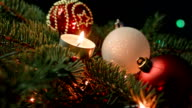 Christmas decoration with candles over dark background video