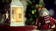 Christmas decoration with snowman, candle, Christmas tree video