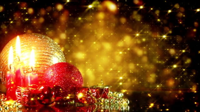 christmas decorations and gold glitter particles loop video