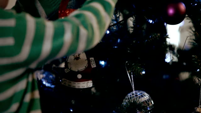 Christmas decorations are hung on a tree video