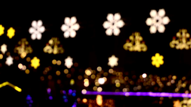 Christmas decorations glowing on a black background video