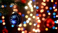 Christmas decorations on tree, branch, bokeh background, out of focus lights, Christmas and Happy New Year defocused abstract background. video