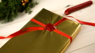 Christmas gift with golden wrapping paper video