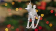 Christmas horse toy rotates at background bokeh video