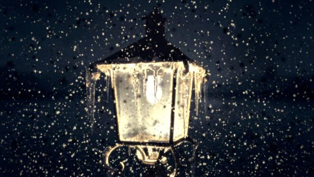 Christmas lamp in falling snowflaks video