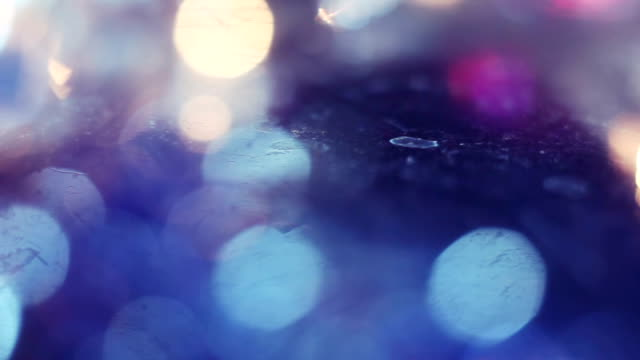 christmas light bokeh reflected in glass panning video