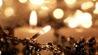 christmas lightbulb and candles close-up seamless loop video