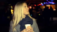 Christmas markets and fairs in Europe. Woman drinking hot coffee video