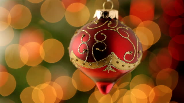 Christmas ornament with blurred lights in background video
