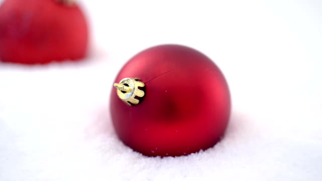 Christmas ornaments on snow video