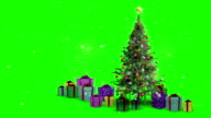 Christmas presents appearing around tree video